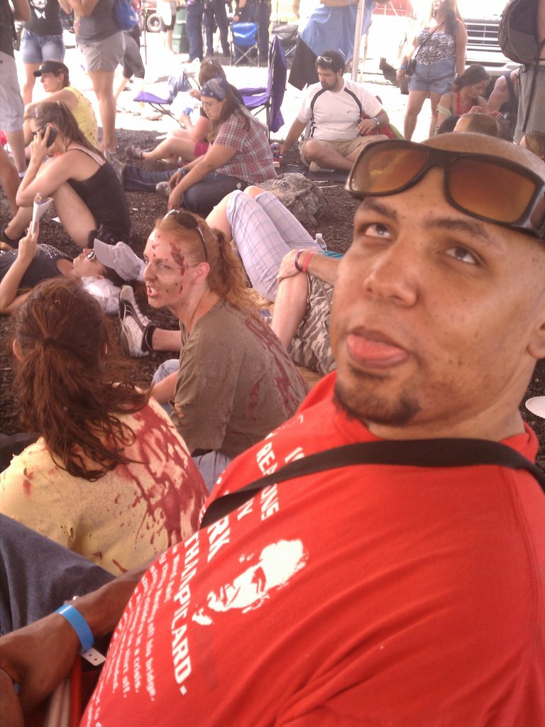 Michael making dead face at zombie crawl.